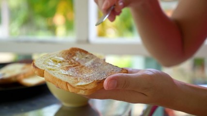 Preparing Toast with Butter and Jam