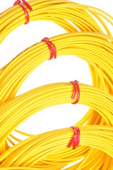 Yellow fiber optic cables isolated on white background