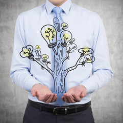 businessman holding lamp tree