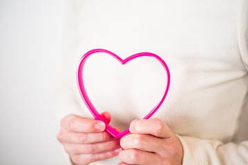 Pink heart on white sweater