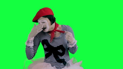 The mime girl cries hysterically