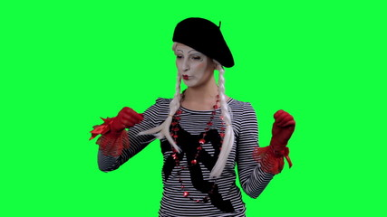 The mime drinks tea from a cup invisible