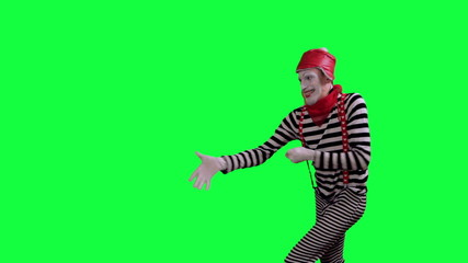 The mime pulls something on the rope