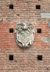 Antique coat of arms figure carved in stone outdoors