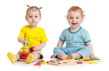 Funny kids playing educational toys isolated