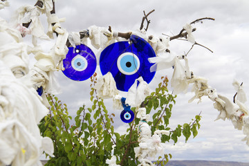 Evil eye charms hang from a tree