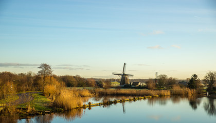 Landscape with windmill and river