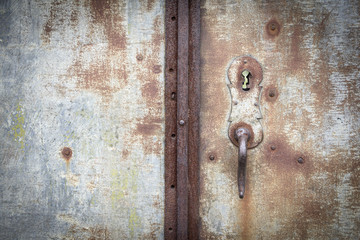 knob and lock of an ancient rusty metallic door