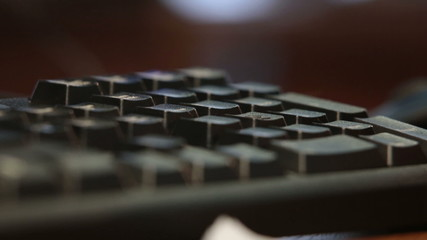 A man typing on the keyboard closeup