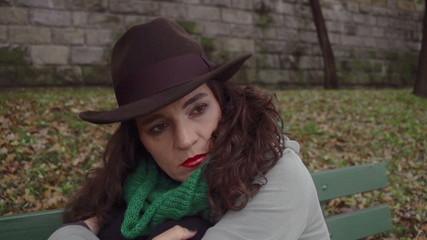 Sad woman sitting on the bench, closeup, steadycam, slow motion