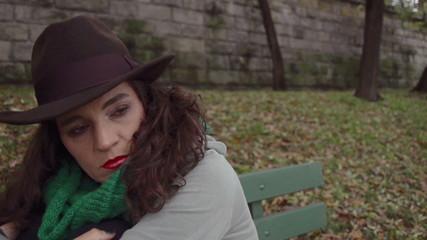 Sad woman sitting on bench, closeup, steadycam, slow motion shot