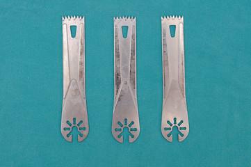 Surgery oscillating saw blades on green cloth.