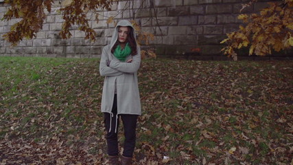 Sad woman standing on boulevard, steadycam shot, slow motion