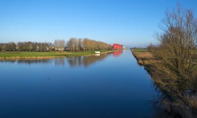 Highrise along a canal under a sunny sky