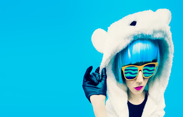 Crazy party girl in hoodie bear on a blue background. positives