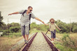 Happy family walking on the railway at the day time. - 75303469