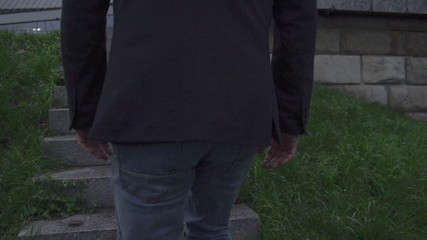 Man walking on steps, steadycam shot, slow motion shot