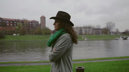 Woman walking next to river, steadycam, slow motion 240fps