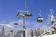 Skiers on a ski lift - 75306256