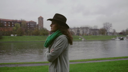 Woman walking next to the river, steadycam shot, slow motion