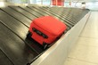 baggage claim suitcase Luggage conveyor belt at airport arrivals last lost suitcase insurance claim concept  - 75306658