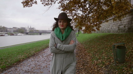 Happy woman walking next to river, steadycam, slow motion 240fps