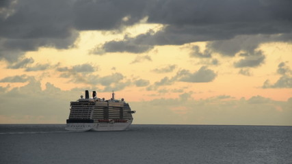 Ocean liner at sea by sunset