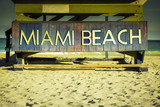 Miami Beach sign on wood background, Florida