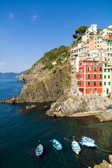 Riomaggiore village on cliff rocks and sea