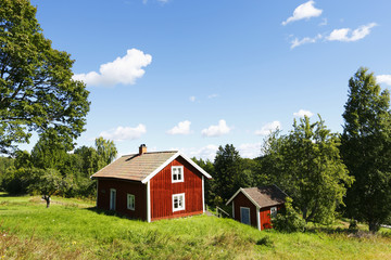 small red farm in rural country surroundings