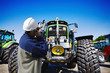mechanic and giant farming tractors