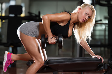 Sexy Woman Doing Exercise For Back