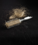 Alopecia concept hairbrush full of loss hair poster