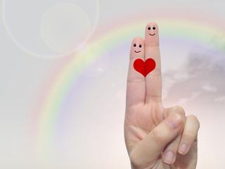 Fingers in love over sky