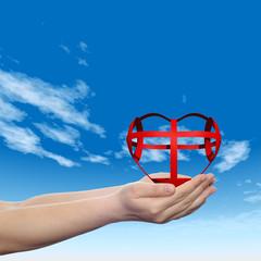 3D conceptual heart held in hands