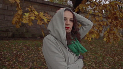 Sad woman taking off hoodie, steadycam shot, slow motion shot