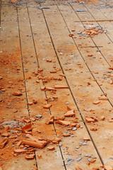 wooden boards floor brick dust