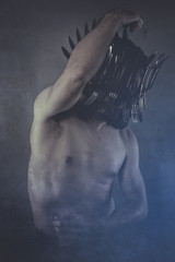 man with crown forks in the head, naked