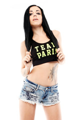 Sensual tattoo girl with t-shirt and shorts