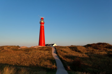 road to red lighthouse and blue sky