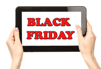 Woman's hands holding tablet with Black Friday text
