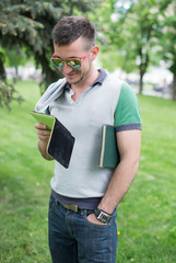 serious student with glasses reading book