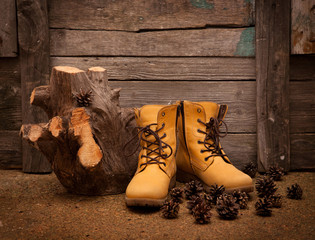 still life with boots on wooden grunge background
