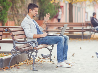 Young man sitting on the park bench