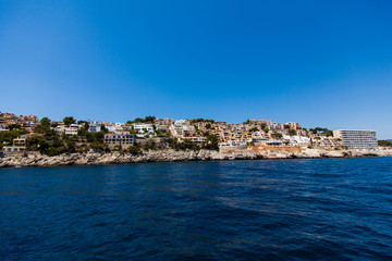Apartment buildings by Mediterranean Sea.  view of Mallorca coas
