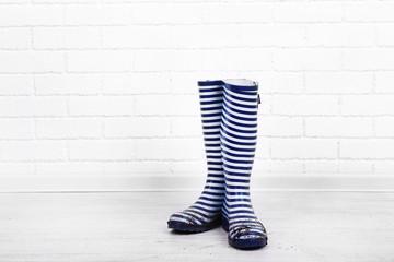 Dirty wellington boots on floor in room