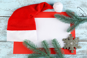 Santa red hat with fir-tree branch and card