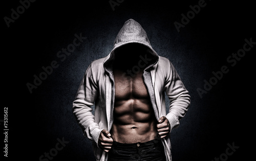 Fototapeta strong athletic man on black background