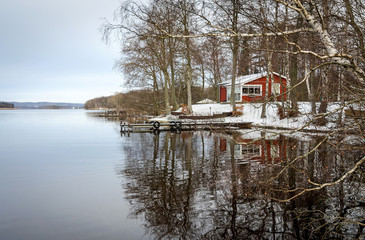 Winter lake reflection in Sweden