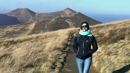 Happy woman walking on mountains